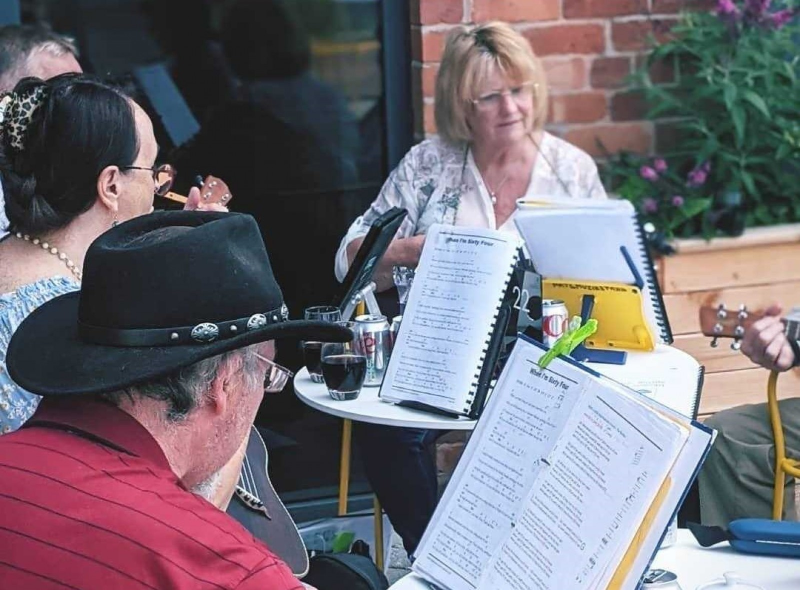 A Ukele Orchestra plays outside the Hub CafeBar